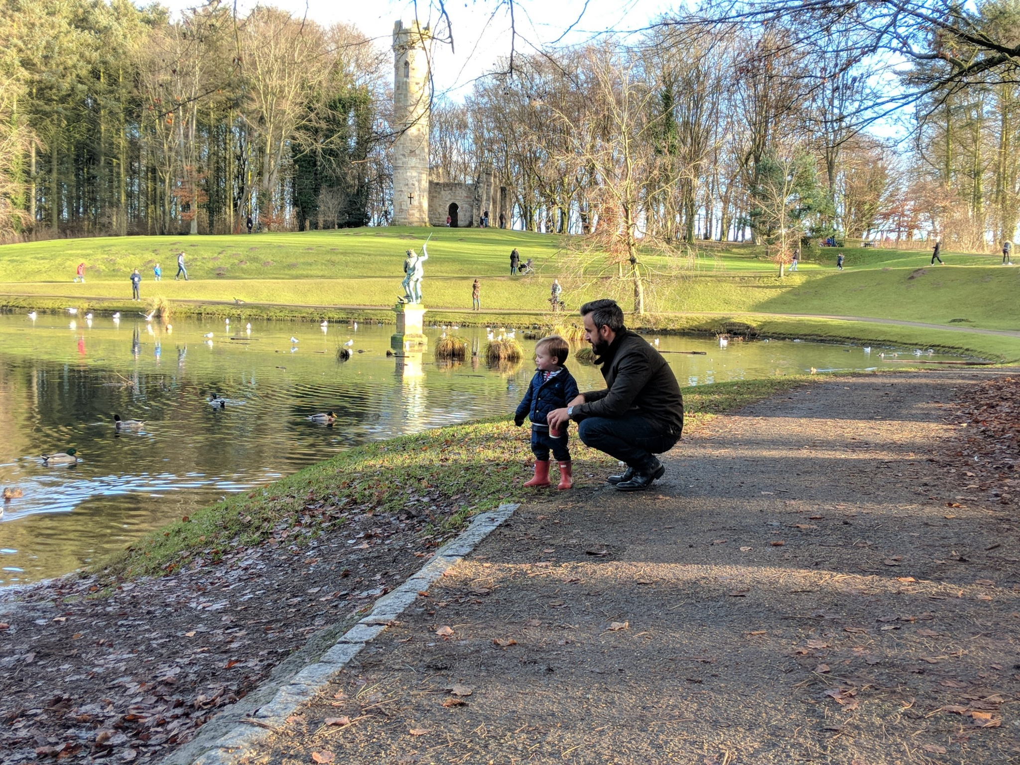 baby and dad looking in lake at hardwick park sedgefield