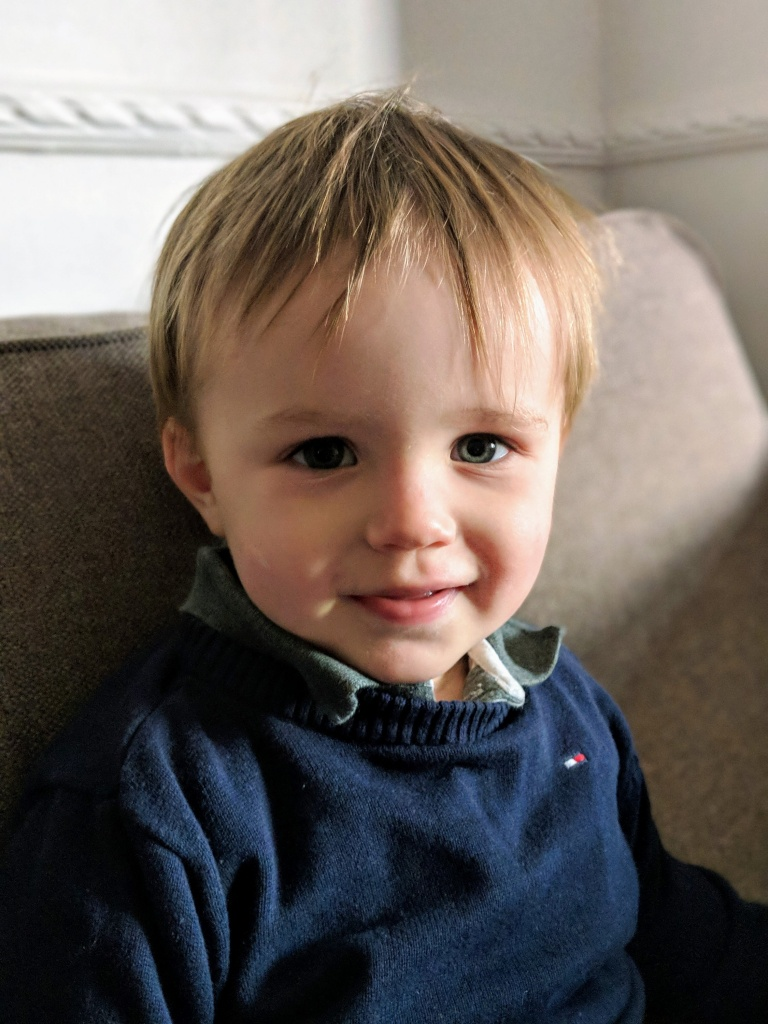 portrait of a one year old sat on sofa