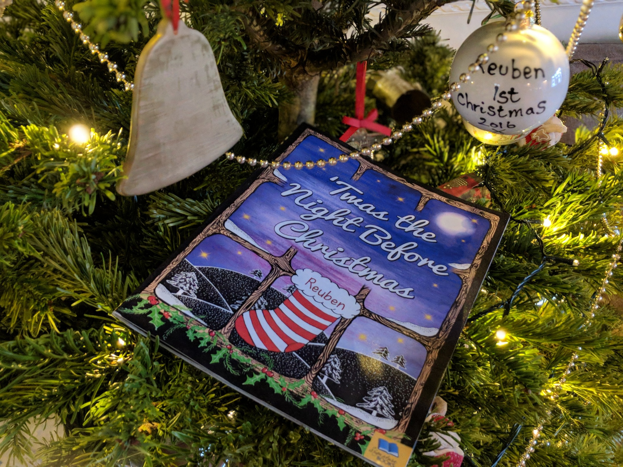 night before christmas book placed on christmas tree