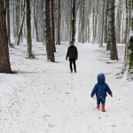 dad and son in hardwock park sedgefield in snow