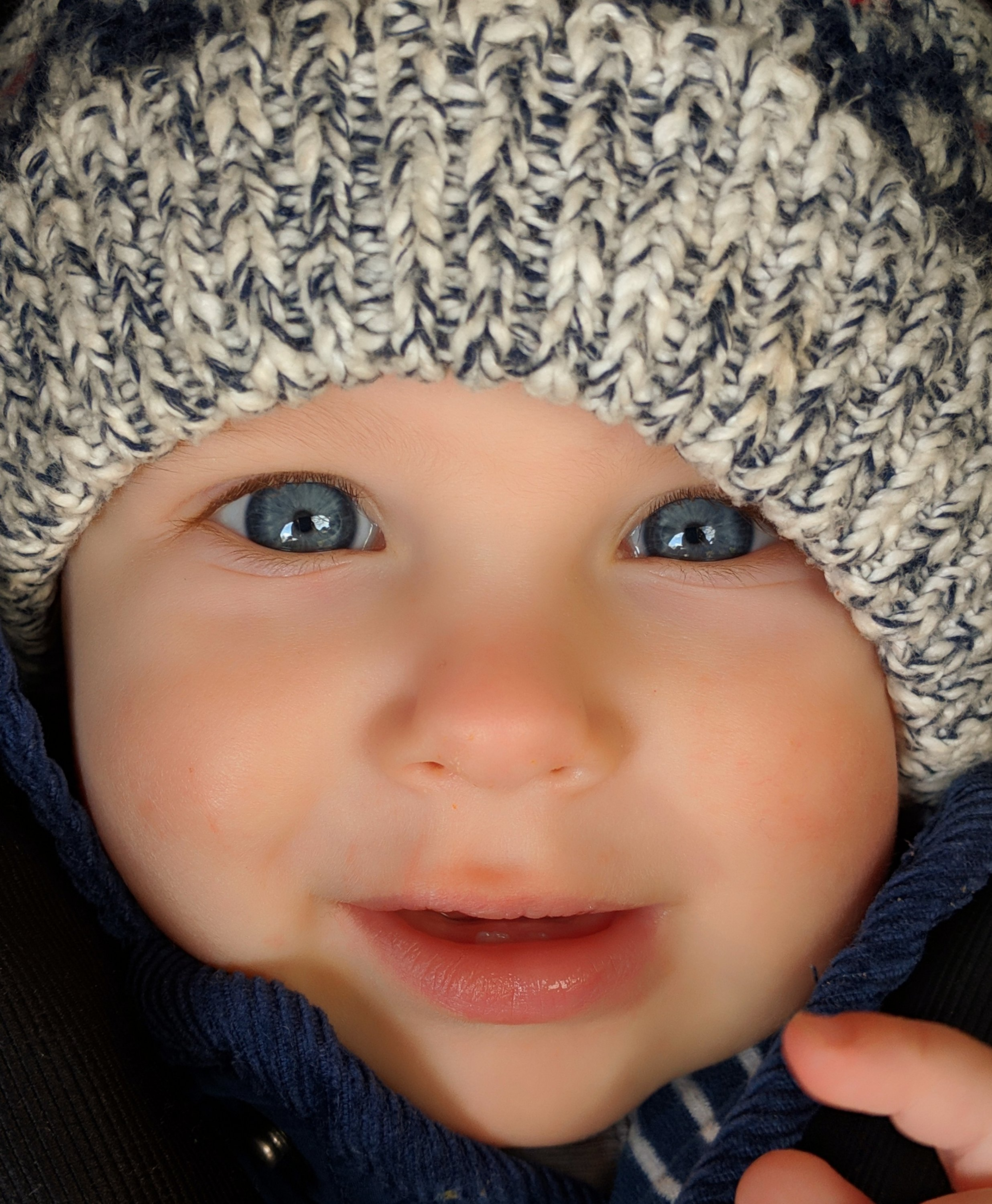 baby dressed in hat looking at camera
