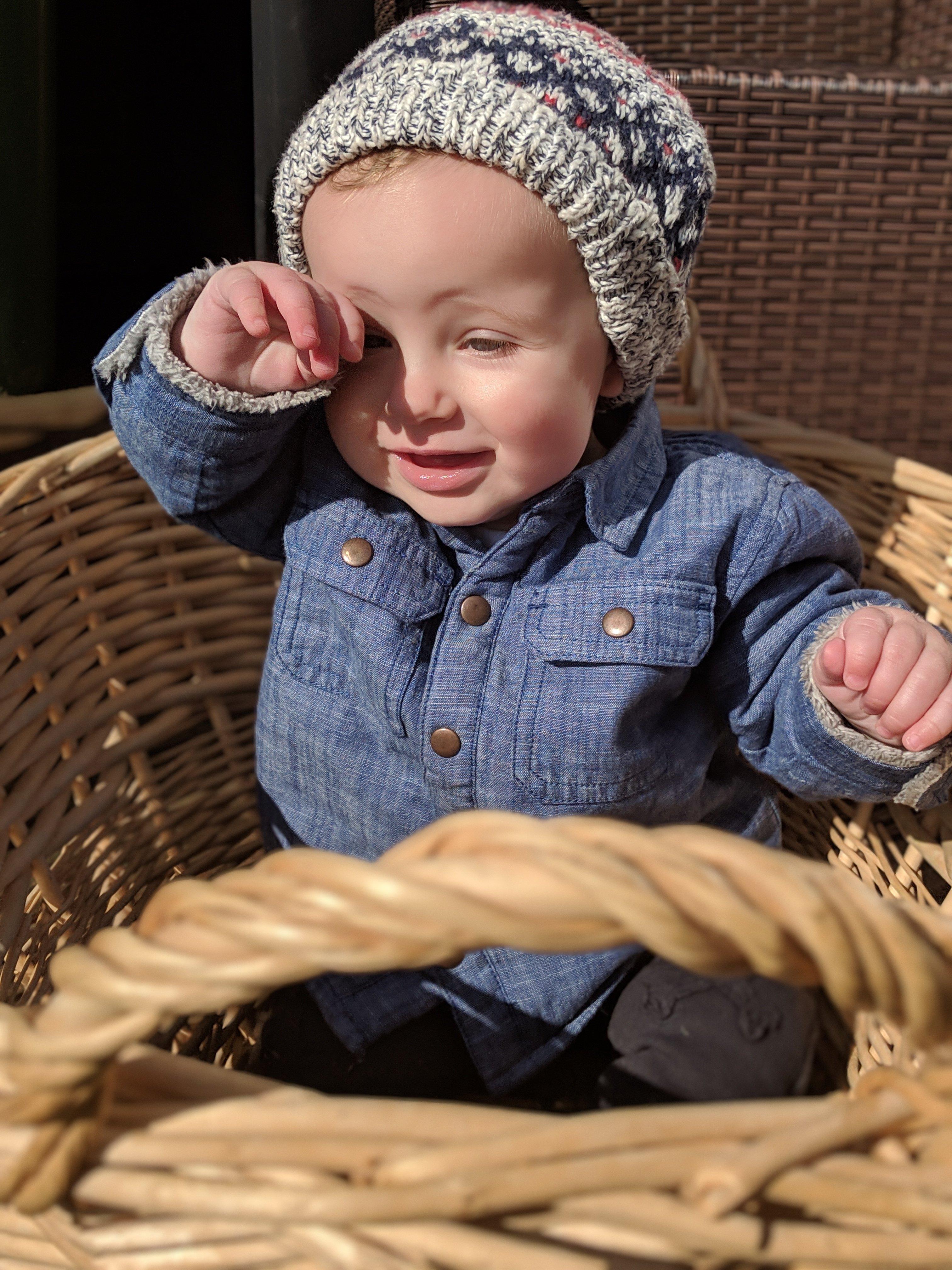 baby in a washing basket