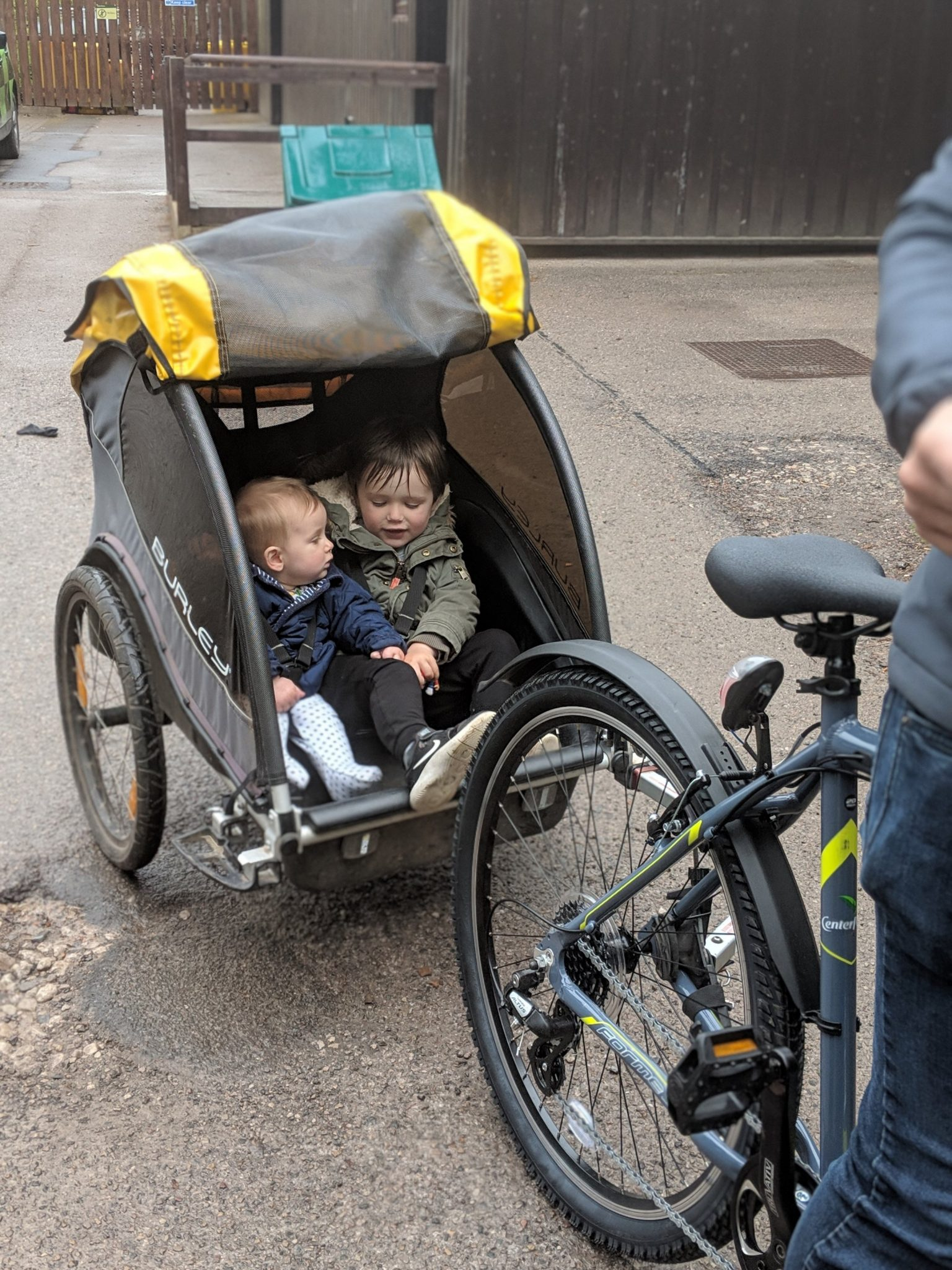 two children in a rear bike carrier at whinfell forest center parcs