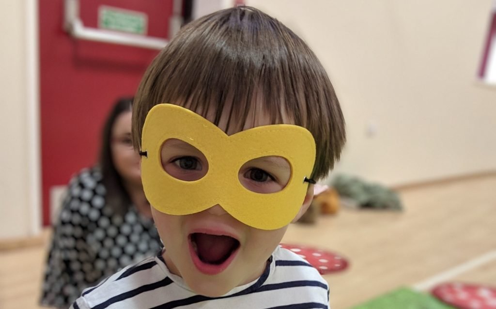 toddler in mask at hartbeeps group