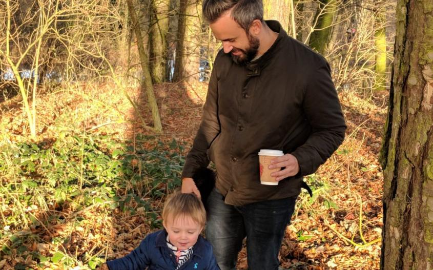 dad and son walking through wooded area at hardwick park sedgefield