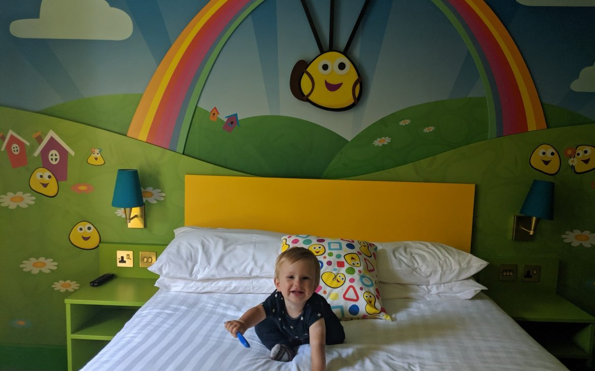 baby on bed of cbeebies hotel room