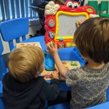 kalma hub playgroup children sitting drawing