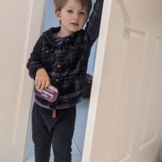 He suddenly looks 10 not 2 😭 (yes he is carrying a tin of Mackerel, because who needs toys 🤷♀️)